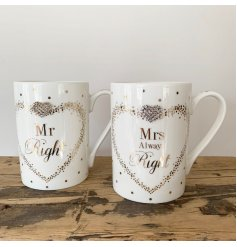 A set of Fine China Mugs beautifully decorated with a silver foil dot decal and added diamonte heart feature