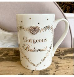 A Fine China Mug beautifully decorated with a silver foil dot decal and added diamonte heart feature