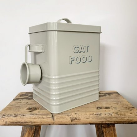 A sage toned storage box complete with a metal scoop and grey text