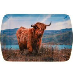 A charming plastic serving tray featuring a Highland Cow design