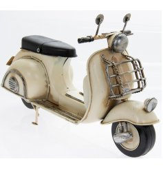 A metal scooter in a vintage cream tone