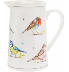 An attractive cream jug, decorated with watercolour design bird varieties. A popular country living style jug