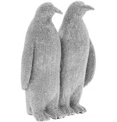 Bring a glitzy vibe to any home space with this charming penguin ornament