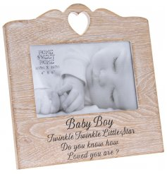 A natural wooden photo frame with a beautiful baby boy sentiment slogan.
