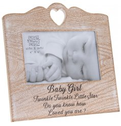 A natural wooden photo frame with a charming baby girl slogan. A classic gift item to showcase your most treasured photo
