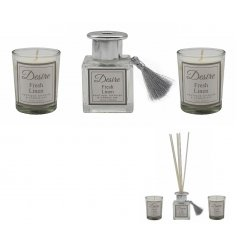 A beautifully packaged set of scented candles and reed diffuser,