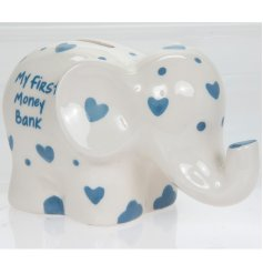 An adorable ceramic elephant shaped money bank with blue heart patterns.