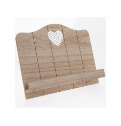 A country living style wooden recipe stand with a mesh heart detail.