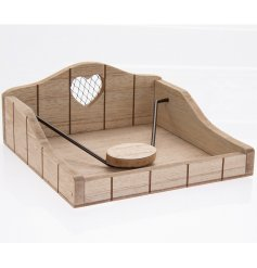A charming wooden napkin holder with a mesh heart feature.