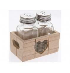 A set of 2 classic salt and pepper shakers stored perfectly inside a rustic wooden crate with twin handles and heart