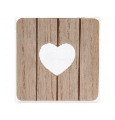 A set of 4 natural wooden coasters, each with a heart shaped cut out design.