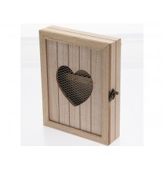 A rustic style wooden key cabinet with a mesh heart shaped cut out and metal clasp. A stylish way to keep keys safe