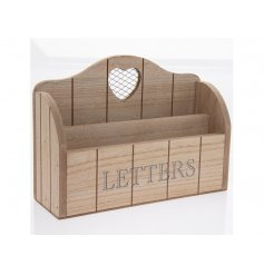 A shabby chic style wooden letter rack with a heart cut out design.