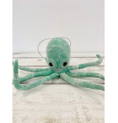 A unique and fabulous hanging octopus decoration with bendy legs and a diamond necklace.