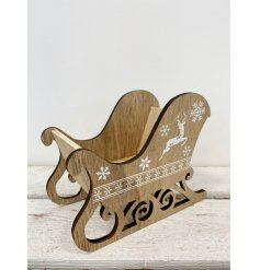 A wooden sleigh Christmas centre piece with a white reindeer and snowflake design