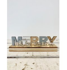 Light wooden Merry Christmas sign with reindeer detail