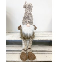 A sitting gonk with a tall wooly hat in natural beige colours