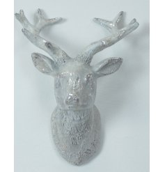 A decorative Stags head featuring a white washed tone and added sparkle effect