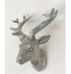 A decorative silver Stags head featuring a white washed tone and added sparkle effect