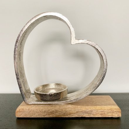 this large metal heart ornament with an added tlight holding feature will be sure to add a Country Charm to any home