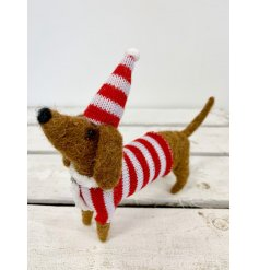 A unique felt dachshund decoration with a knitted hat and jumper.