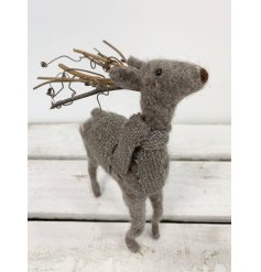 A gorgeous grey felt reindeer with a gold and grey knitted scarf and coat and twig antlers.