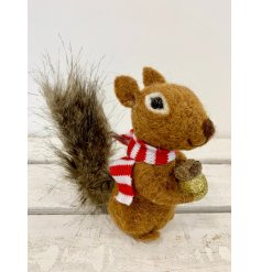 A gorgeous felt squirrel with a tall bushy tail, red striped scarf and golden acorn
