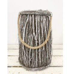 A snowy white washed lantern made from woodland twigs to give you a cosy feel on a cold winter night