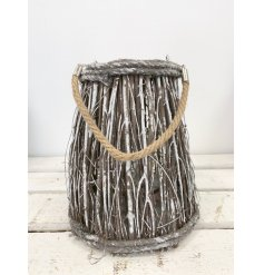 A snowy woodland twig lantern to help you feel cosy on a cold night