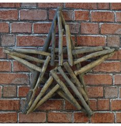A large decorative star built up of chunky natural twigs