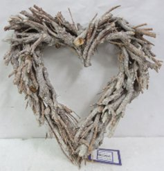 this heart shaped wreath will be sure to bring a Rustic Charm to any front door at Christmas