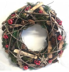 A festive themed round wreath with added red accents and features