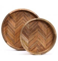 Bring a gorgeous natural wood feature to your home with this set of assorted sized round wooden serving trays