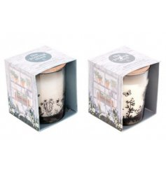 Gift boxed scented candle in a glass pot with a wooden lid - part of the Love Grows Here range. Approx 8 x 10 cm