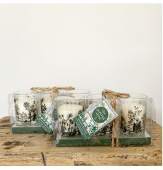 A set of 3 beautifully decorated glass votives with scented candles set inside.