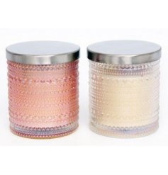 An assortment of blush pink and cream toned candle pots, featuring stylish bubble ridged decals and an iridescent coatin