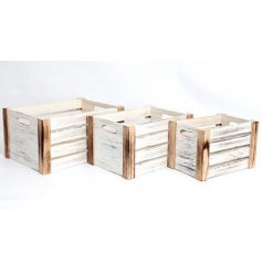 A set of 3 wooden crates each set with its own size and white washed tone