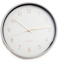 Chic grey coloured wall clock will be sure to bring a trending tone to any home space