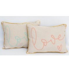 A quirky assortment of pink and blue themed cushions featuring a gold trim decal and scripted Love text