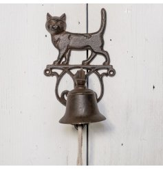 A rustic cast iron door bell with cat feature