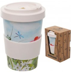An eco friendly bamboo travel mug with a beautifully printed botanical decal around it and additional bamboo cap lid