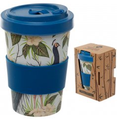 An eco friendly bamboo travel mug with a beautifully printed peacock decal around it and additional bamboo cap lid
