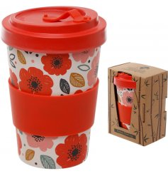 An eco friendly bamboo travel mug with a beautifully printed floral decal around it and additional bamboo cap lid