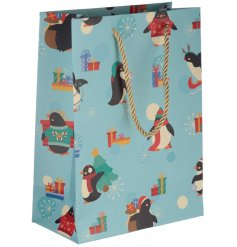 Covered with cute festive penguins, this printed gift bag will be perfect for presenting gifts at Christmas!