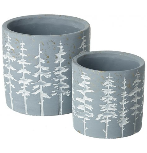 A set of 2 rustic planters with a forrest tree design. Complete with a distressed, gold speckled finish.