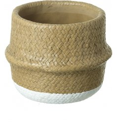 Set with a woven wicker inspired surround and added white block base tone