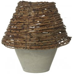 A stylishly simple little concrete pot with a natural toned woven wicker shade