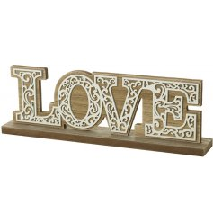 A natural wooden block plaque featuring a white LOVE text
