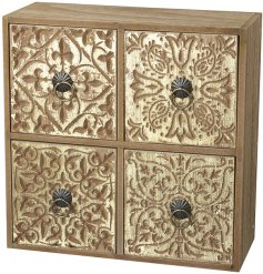 A 4 space draw unit featuring assorted embossed decals and brass ring handles