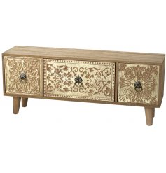A beautifully vintage inspired wooden draw chest featuring assorted carved patterns and brass handles